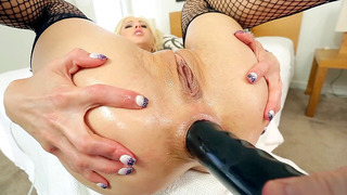 Holly Hanna has her ass hole and throat riuned by a giant double-headed dildo